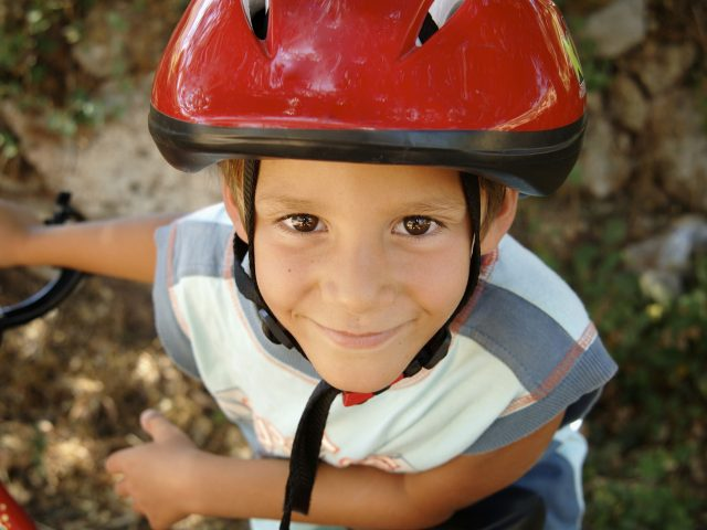 Boy smiling with a bike helmet