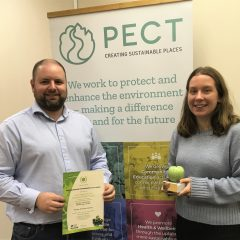 PECT's Interim CEO Stuart Dawks and Warm Homes Project Officer Nikki Dekker with the Green Apple Award