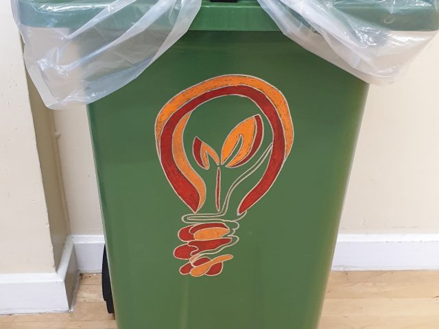 A bin with drawings on