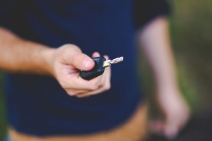 Man receiving keys to new car after looking to sell a car online