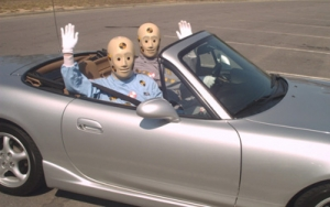 Crash test dummies sat in convertible