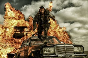 Tom Hardy as Mad Max on top of Mercedes Stretch Limo