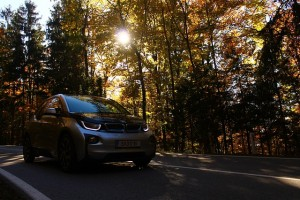 BMW i3 driving on a road, why not sell your car online and upgrade?