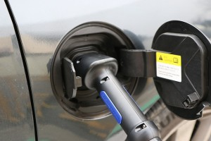 Close up of electric car charging, sell your car quick with Wizzle and upgrade today