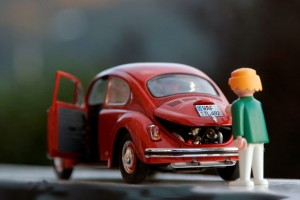 A Playmobil man opening the boot of a beetle after using the Wizzle app