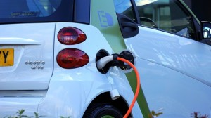 An electric car plugged in to charge