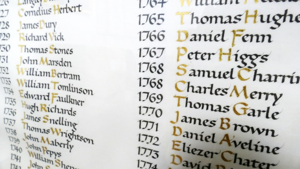 a list of dates and names, highlighted with gilding