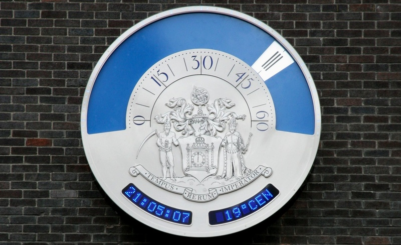 A close up of the clock dial