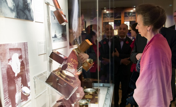 The Princess Royal looking into a showcase full of chronometers