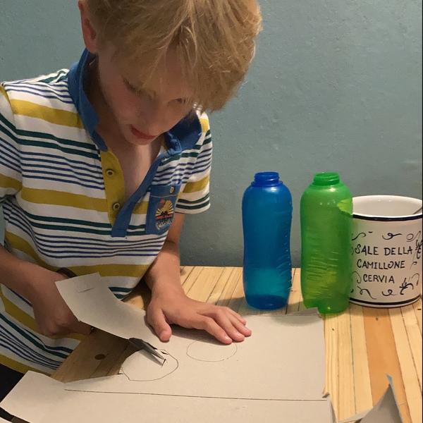 boy cutting out card
