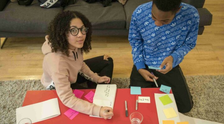 Two young people doing co-design with Create/Change