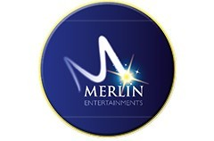 Circular Merlin Entertainments logo on a white background