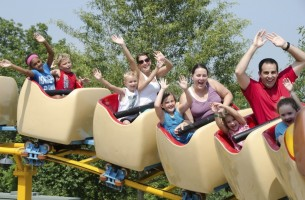 A family riding a rollercoaster