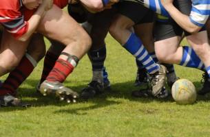A close up of feet in a rugby scrum