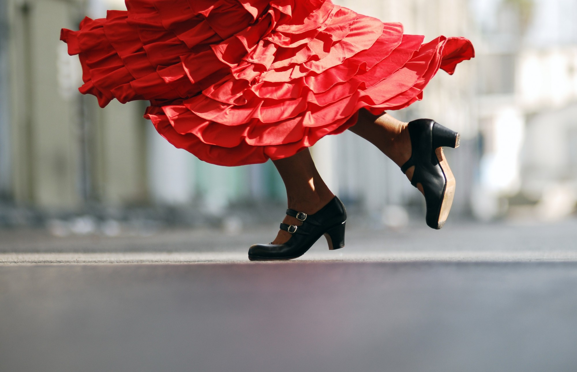 Female Flamenco dancers shoes with their dressing spinning around as they dance