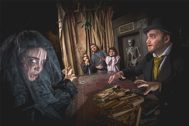 Actors in Victorian costume in Edinburgh dungeon during a re-enactments