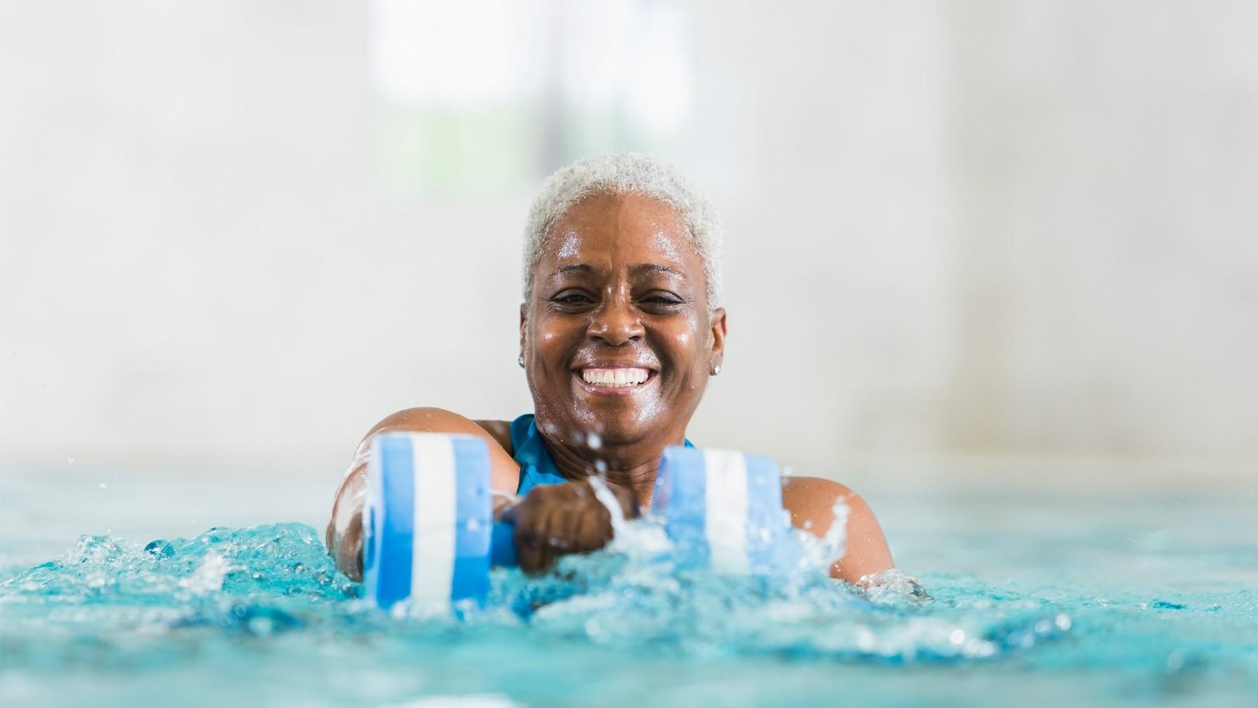 Woman doing aquarobics