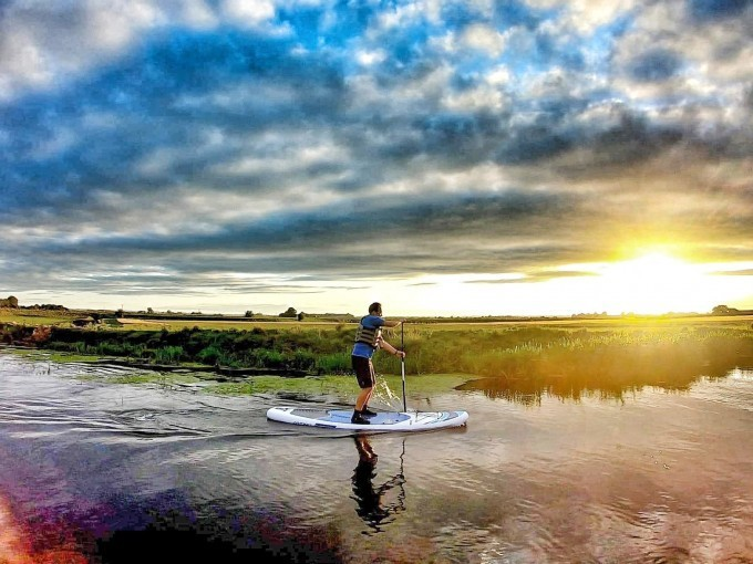 Paddling boarding at sunset