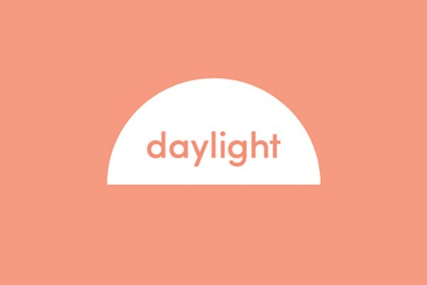 Daylight logo, the word daylight is written in salmon pink within a half circle