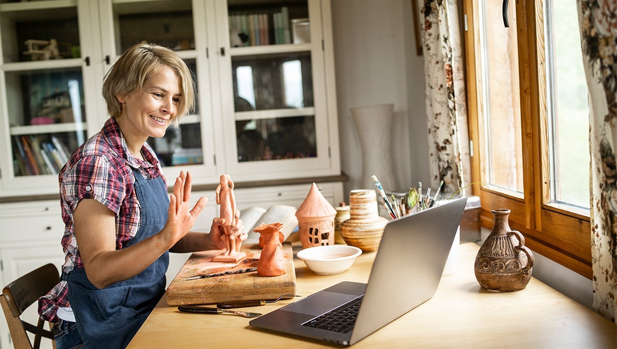 A woman holding a virtual event for clay modelling