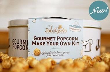 Popcorn kit box surrounded by gourmet popcorn