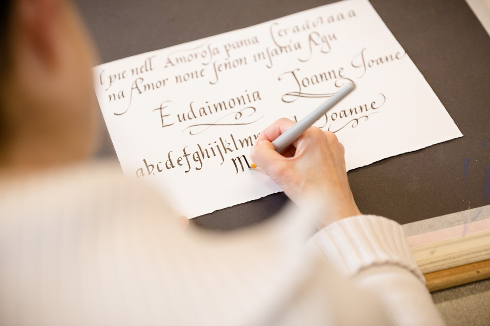 A lady doing calligraphy lettering