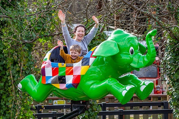 A mother and son on an elephant ride at chessington world of adventures