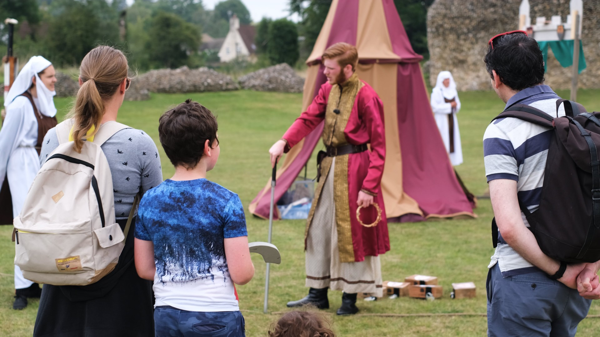 People at an Adventure Out event with actors in historic garb