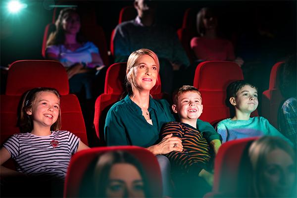 A mum and three boys at the cinema