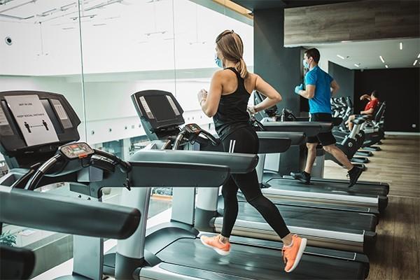 A woman on a treadmill in a gym