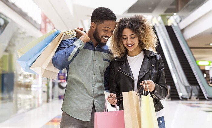 Smiling couple looking in their shopping bags