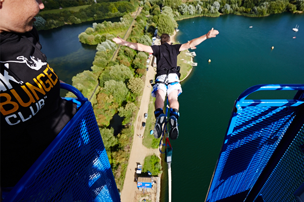 Someone doing a bungee jump over a lake