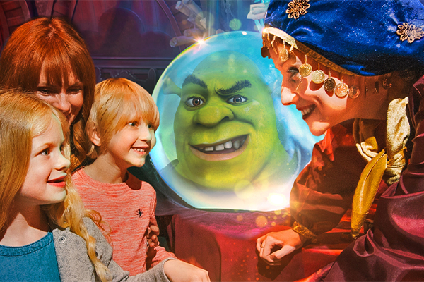 Two little girls with a fortune teller at shrek's adventure