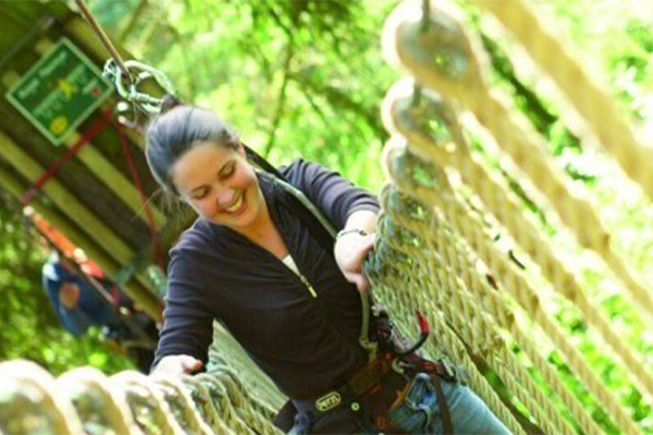 A woman in the high ropes course