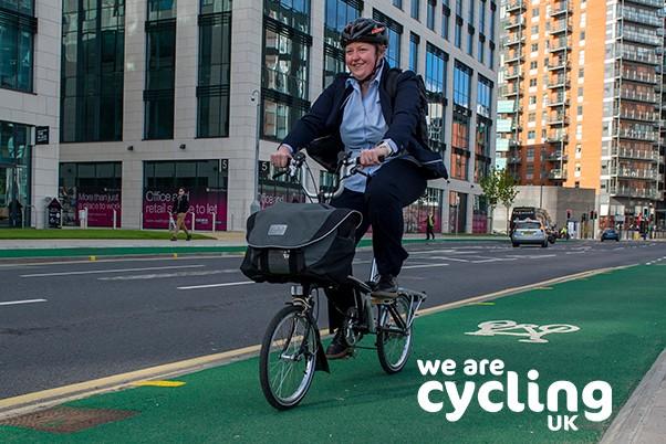 Woman cycling through city on a fold-up bike