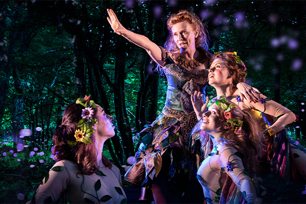 People playing characters in a midsummer nights dream play at kew gardens
