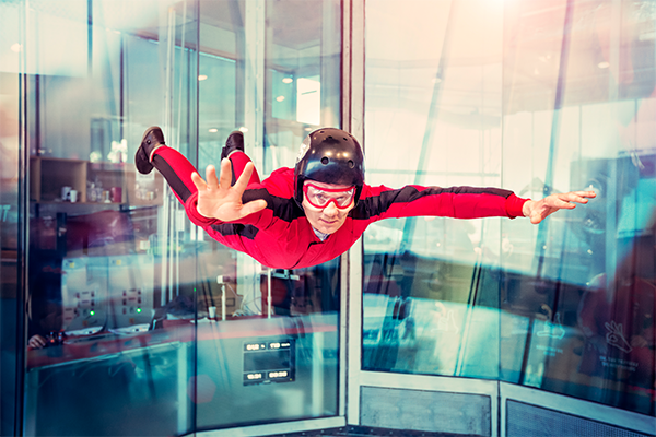 someone indoor skydiving