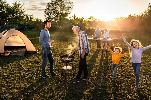 Family camping in a sunset lit field