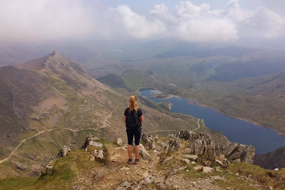 Woman stood on the Watkin Path on Mount Snowdon