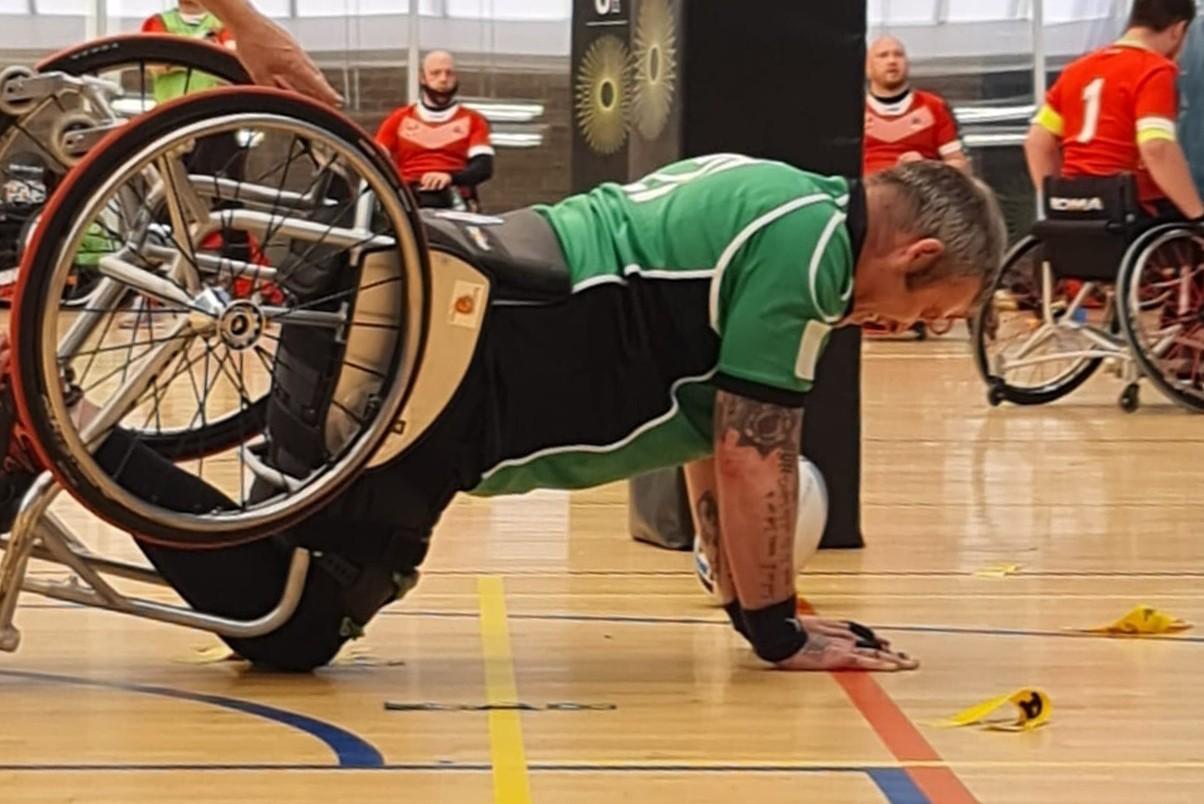 Wheelchair basketball player falling down