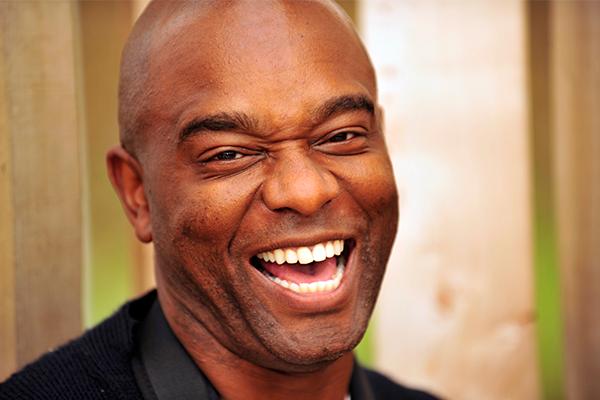 A headshot of David Lindo, The Urban Birder, smiling