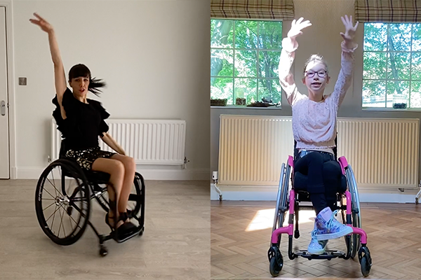A woman and a little girl, each in a wheelchair, dancing at home