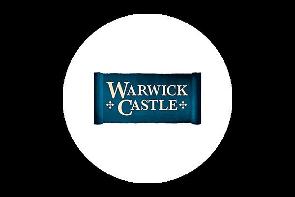 Warwick Castle logo on a white circular background