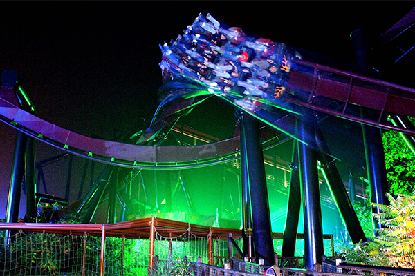 People riding a rollercoaster in the dark at thorpe park