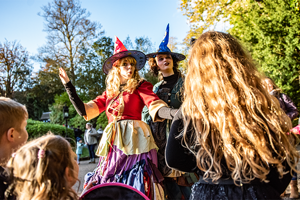 Witches performing in front of kids in the day at warwick castle