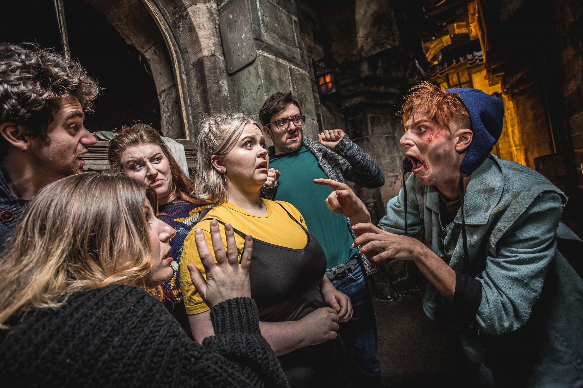 A man scaring adults at the edinburgh dungeon