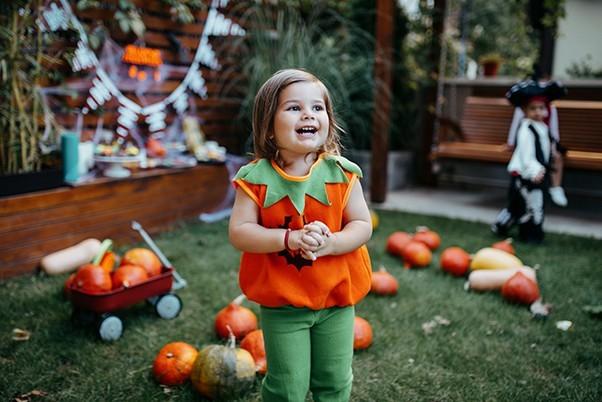 Little girl dressed up as a pumpkin for Halloween