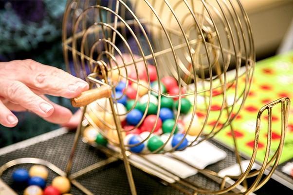 Hand spinning a bingo ball wheel