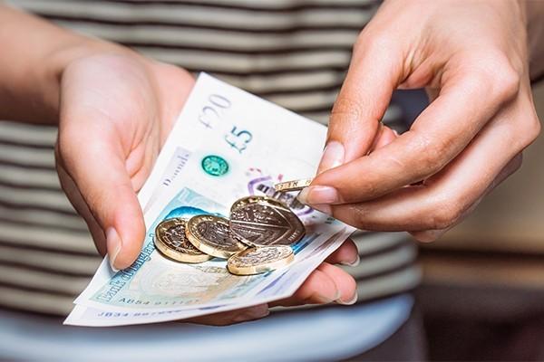 cash money in someone's hand