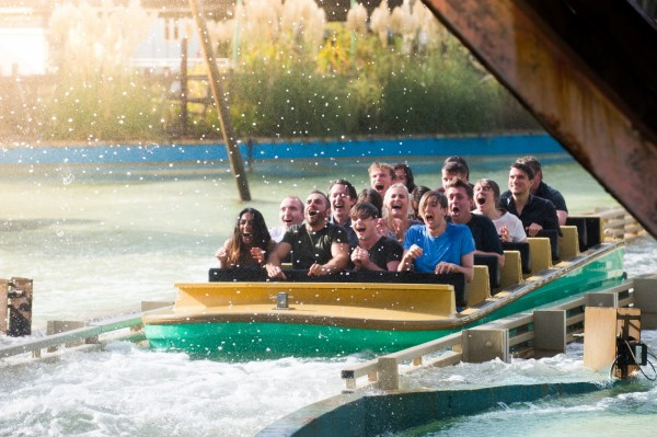 People smiling as they ride the log flume at Thorpe Park